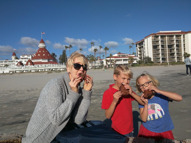 Eating Apple Fritter Donuts on Coronado Beach in San Diego, CA
