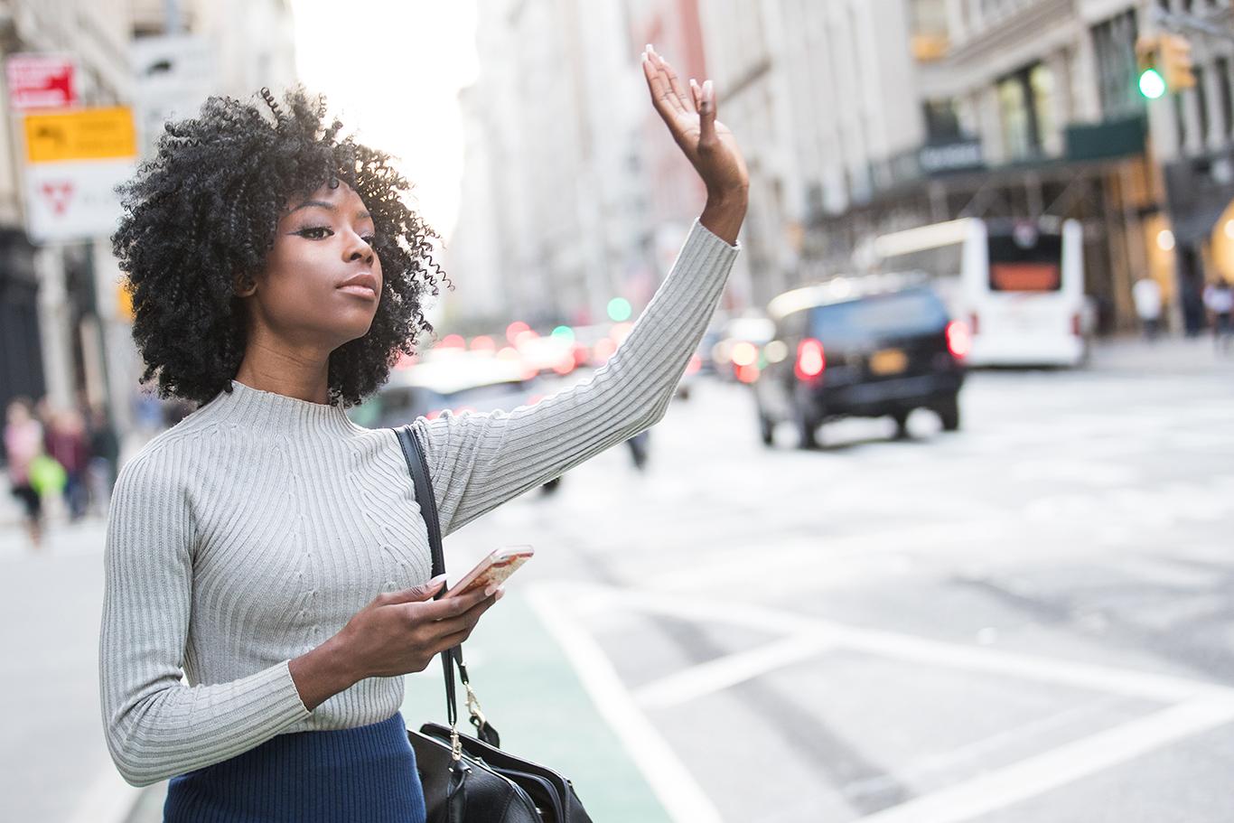 Woman Hailing Ride-Sharing App Driver
