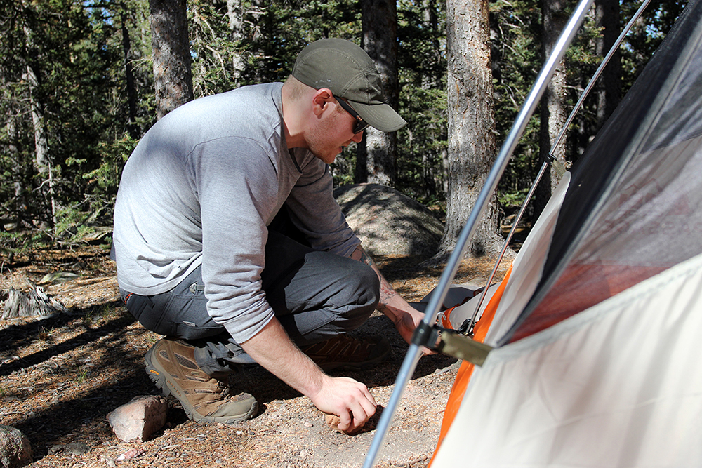 Staking Tent at Pike National Forest Outside Barr Camp