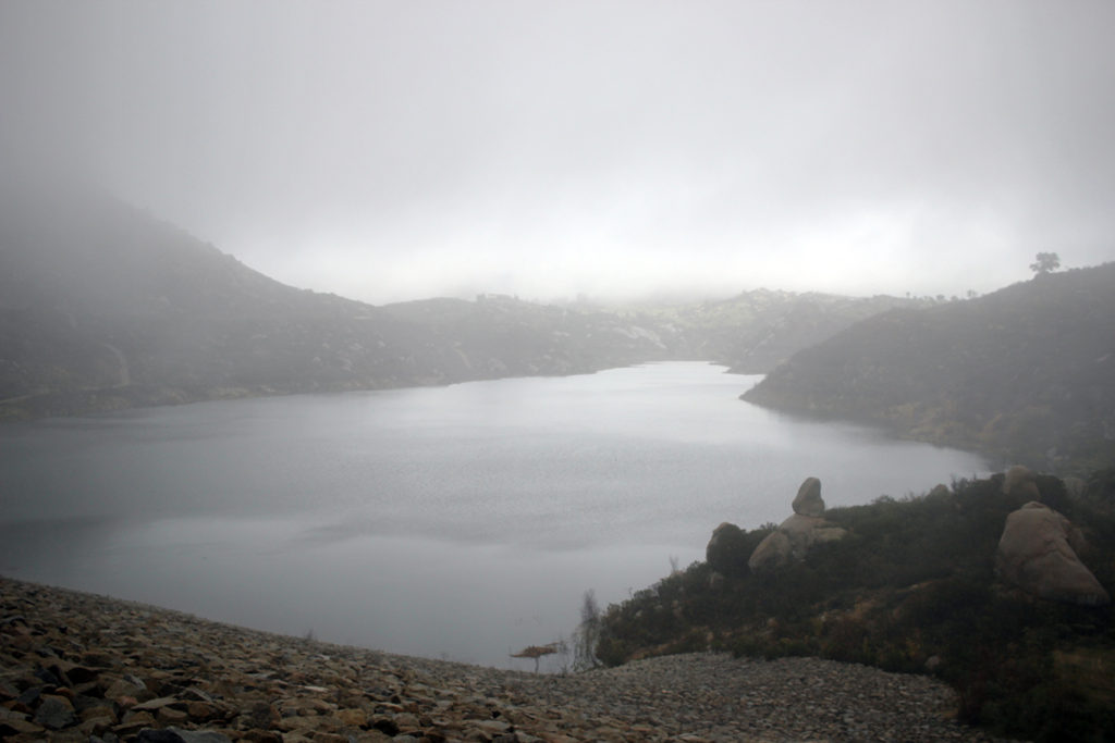 The misty, rainy view at the top of Ramona Dam on the Blue Sky Reserve hike