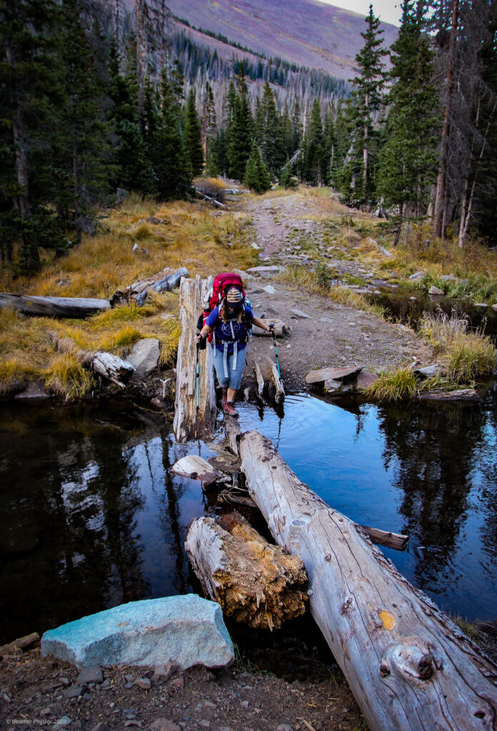 Lori Crossing Water on Log at Humboldt Peak, Colorado