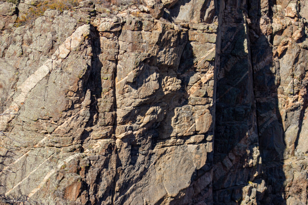 Pink Streaks of Pegmatite through Dark Granite at Black Canyon of the Gunnison National Park - Canyon Walls