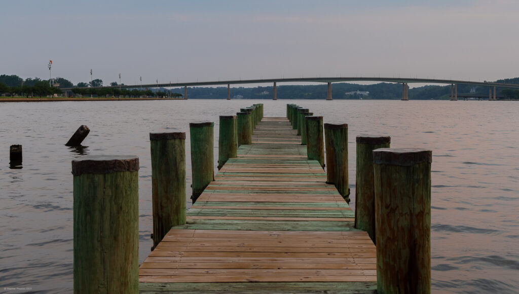 Green Wooden Dock Facing Hill Bridge on the United States Naval Academy Yard in Annapolis, Maryland